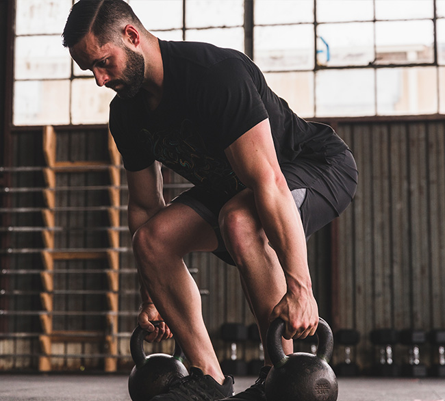 Athlete performing kettlebell rows