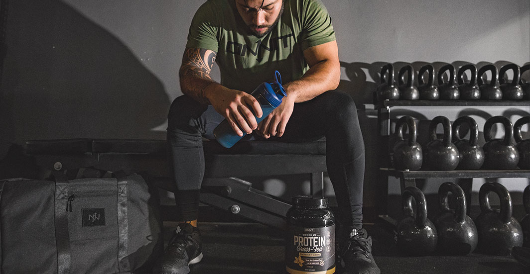 Athlete recovering after workout with whey protein shake